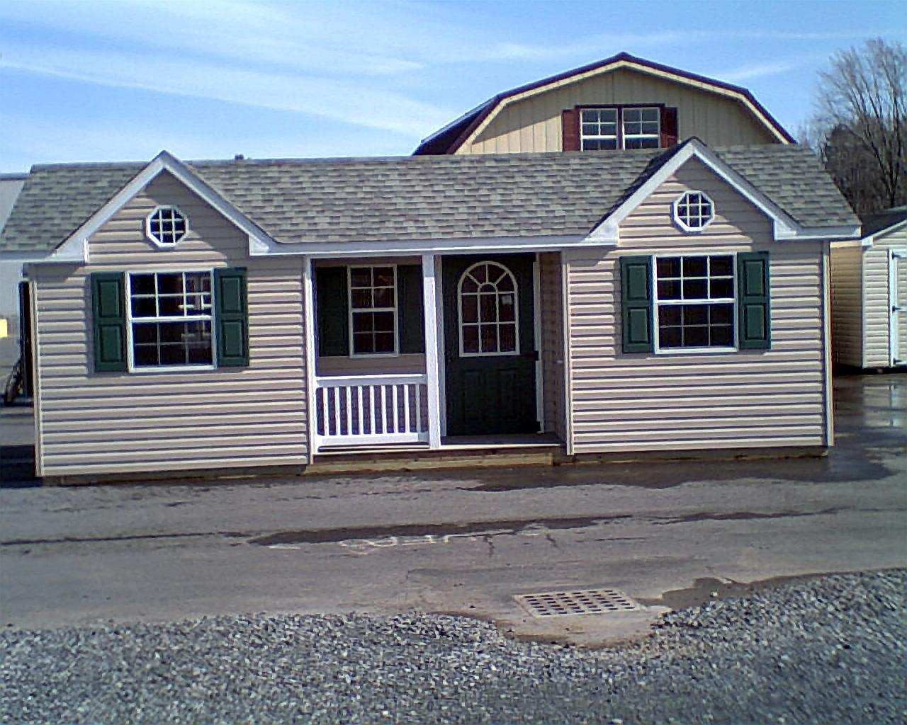 Deluxe with dormer transom windows and cupola - Vinyl Cottage Twin Peaks Vinyl 12 X 24 With 6 Foot Porch Front View