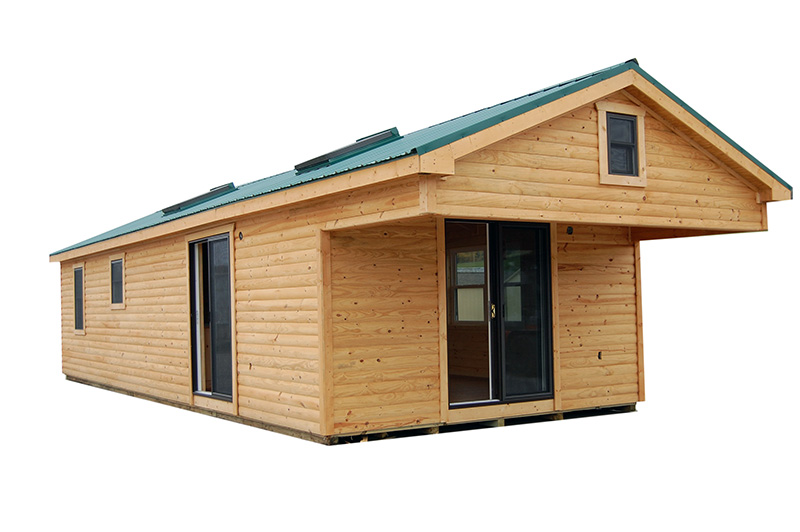 12 x 36 Log Cabin Single Story with Overhead to be attached to posts at location.